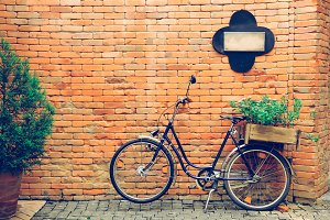 Bicycle with old brick wall in vintage tone with copy space
