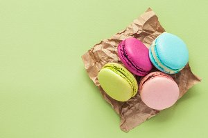 Macaroons on green pastel background