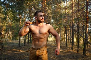 Lumberjack with a naked torso.