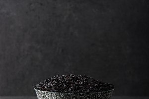 Black rice on black background