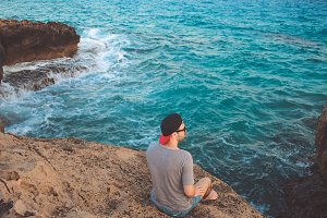 Man relaxing near ocean