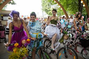 fashionable dresses on bicycles
