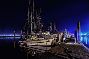 Fishing boats moored at night