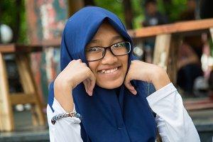 The girl in glasses smiling