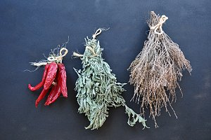bunches of dried herbs and chillies