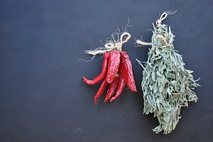 bunch of dried herbs and chillies