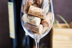 Wine glass with corks
