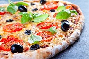 Pizza with prosciutto (parma ham)