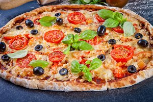 Pizza with prosciutto (parma ham)