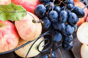 Fresh red apples and dark grape