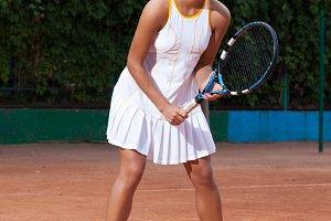 Beautiful woman in a tennis dress