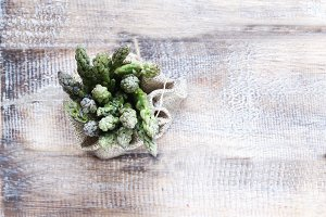 Bunches of asparagus lying on a wooden table