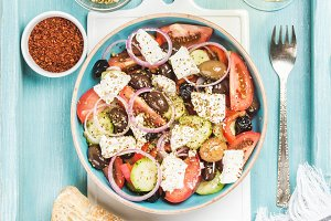Greek salad with bread slices