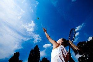 tennis woman developing ball service