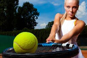 Tennis ball on the racket