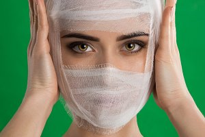 The woman with bandage