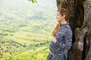 Pregnant woman on the nature.
