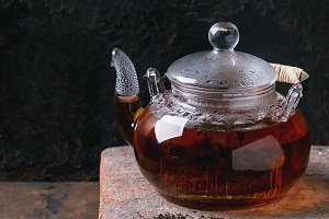 Glass teapot with black tea