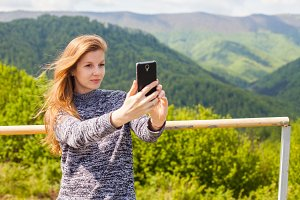 young woman is doing selfie