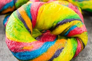 Colorful bagels on a wooden table