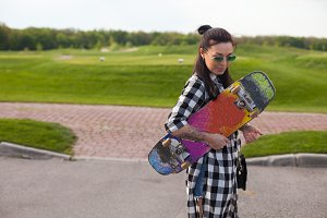 woman is standing with an old skate