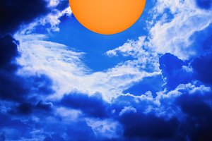 Sun in the sky with clouds