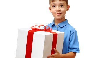 Happy child holding big gift box