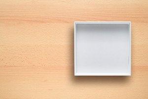 White cardboard box on desk