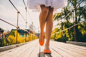 Bright orange wedding shoes on bride