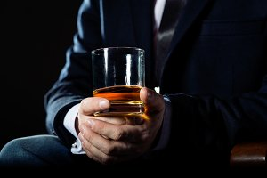 Serious businessman holding  whiskey