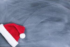 Santa cap on erased chalkboard