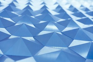 Blue low poly geometric abstract background in embossed triangular and polygon style
