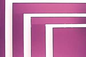 Photo of light angles in bright pink background