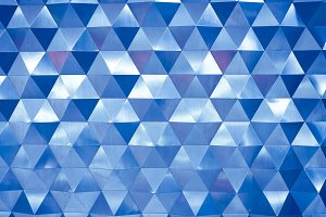 Blue low poly geometric abstract background in rumpled triangular style