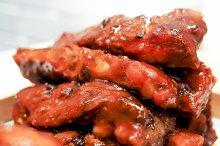 Closeup of pork ribs on white plates