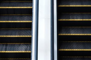 Close-up of escalator going up and down