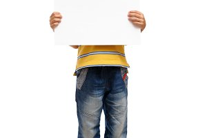 Happy child holding blank poster