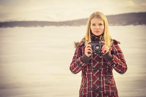 Young Woman with retro photo camera