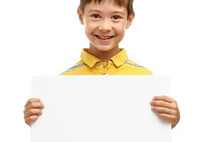 Happy boy holding blank poster
