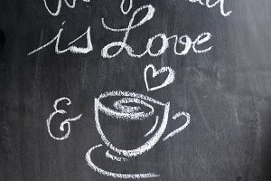 all you need is love and a good cup of coffee with coffee beans on the chalkboard. toning. selective Focus
