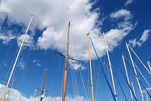 boats masts, blue sky and clouds