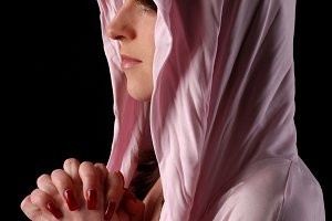 woman in pink hood is praying