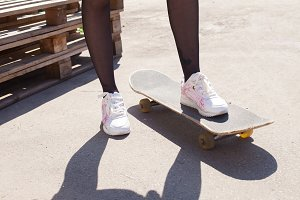 One girl's leg on the skateboard