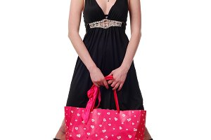 woman in black dress with pink bag
