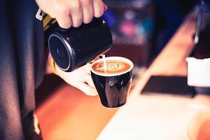 Barista making hot latte