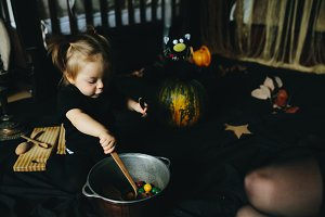 little girl playing in a witch