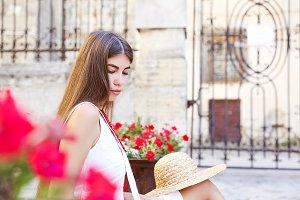Pretty stylish girl with straw hat