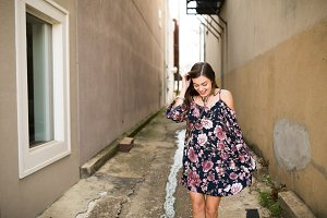 Girl in Floral Dress in Alley Way