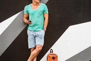 Stylish fashion man traveling