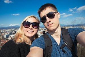 Happy couple traveling photo selfie